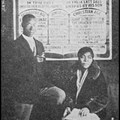 G. P. Bowser standing before one of his preaching charts and his wife Francis (Fannie) Rebecca, holding the Bible.